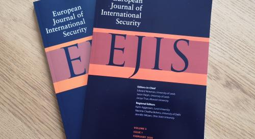 EJIS journals on a coffee table